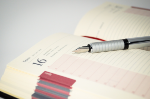 Image of a calendar and pen