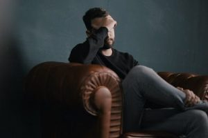 Discouraged man sitting on the couch